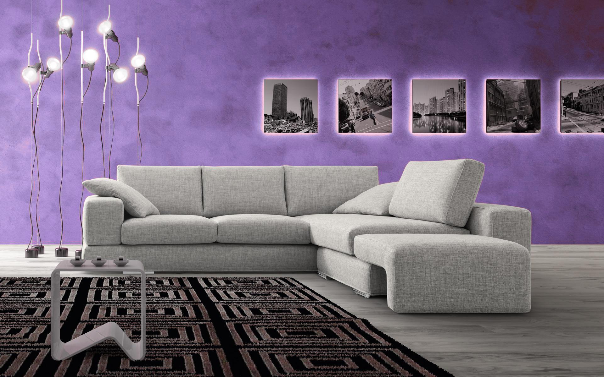 Divano angolo gusto con parete lilla dimarcolor for Parete attrezzata con divano